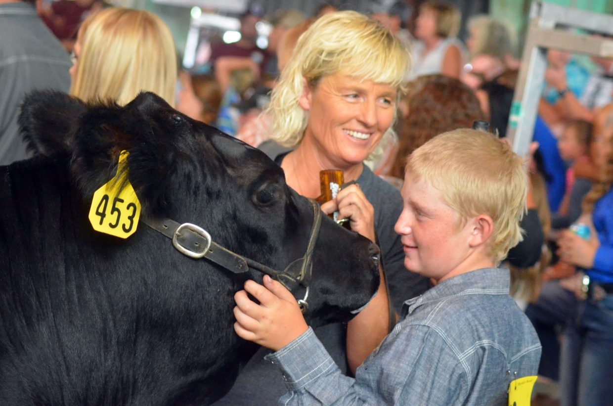 Joyce Barnes and son Cactus relax between rounds of the Moffat County Fair beef show Thursday.
