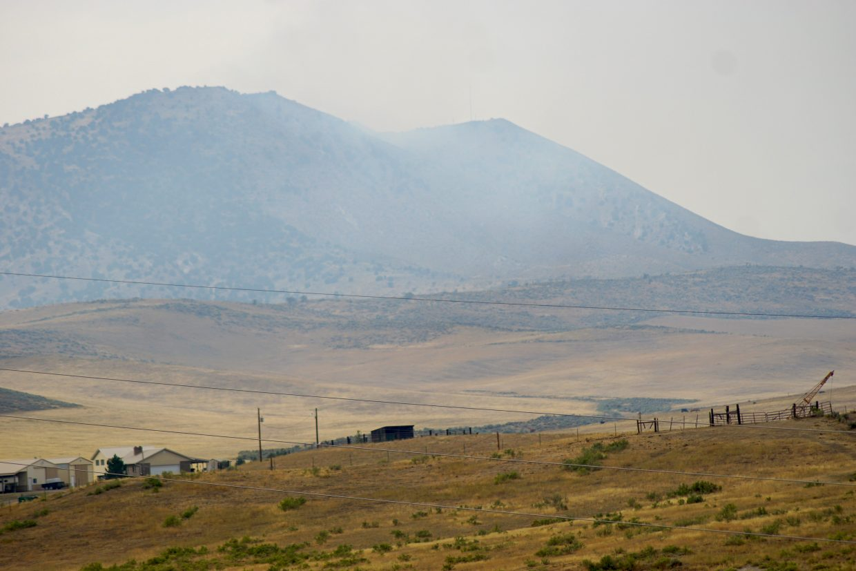 Heavy wildfire smoke rises above the north east side of Cedar Mountain.