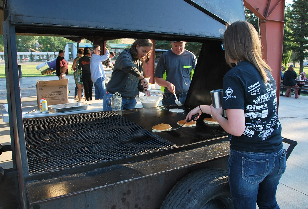 FFA members cook up pancakes for the crowd Saturday at the Moffat County Fair.