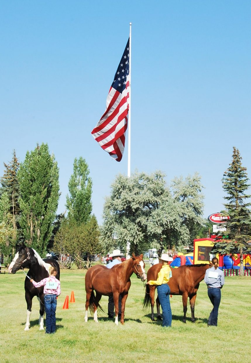 A group of horses and their young handlers gather Saturday at the Moffat County Fair.