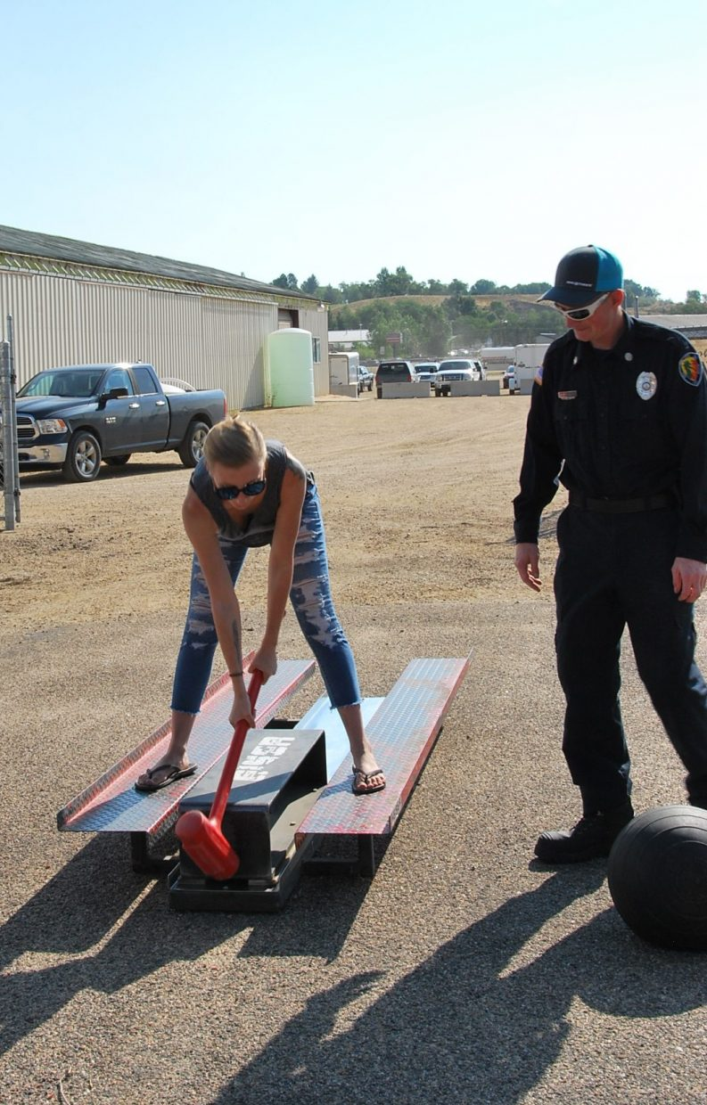 Moving a metal sled with a mallet across the parking lot is a test of strength as part of the firefighter course at the Moffat County Fair. It usually takes about 10 to 15 swings in the official firefighter training test according to Craig firefighters.