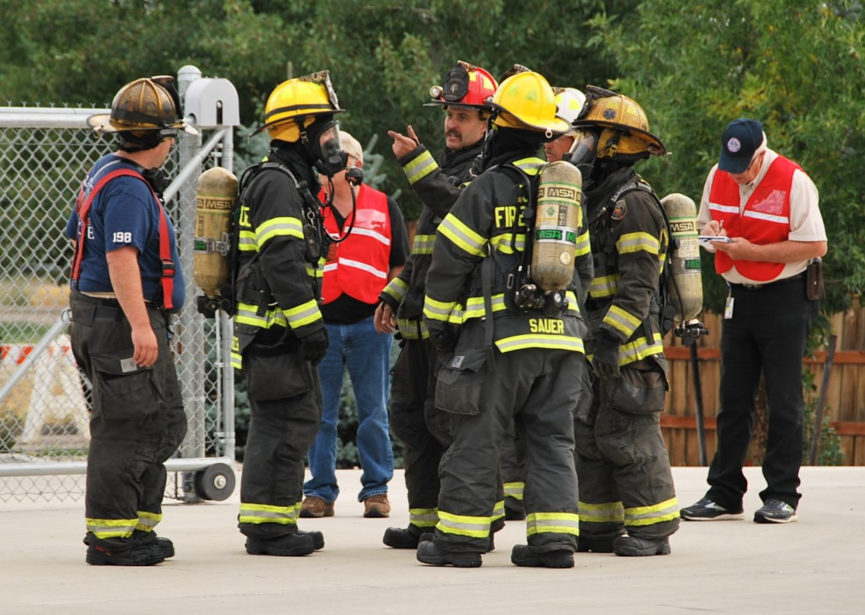 A team of firefighters is briefed before a rescue.