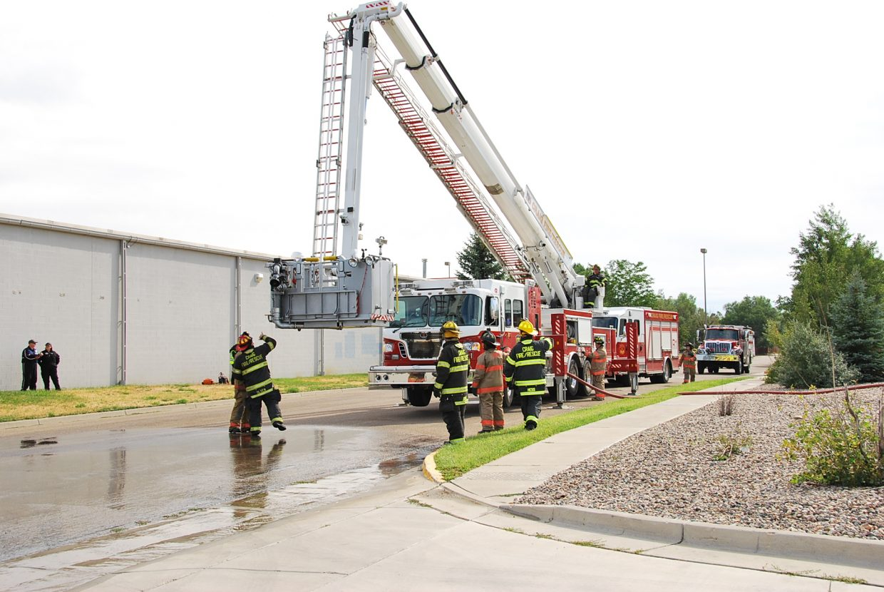 A fire engine sets up to be used as a decontamination shower.