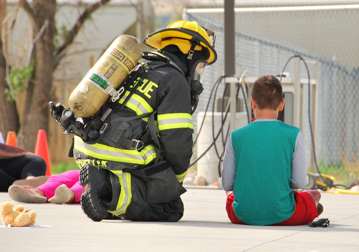 A Craig firefighter talks with a volunteer victim during the training exercise.