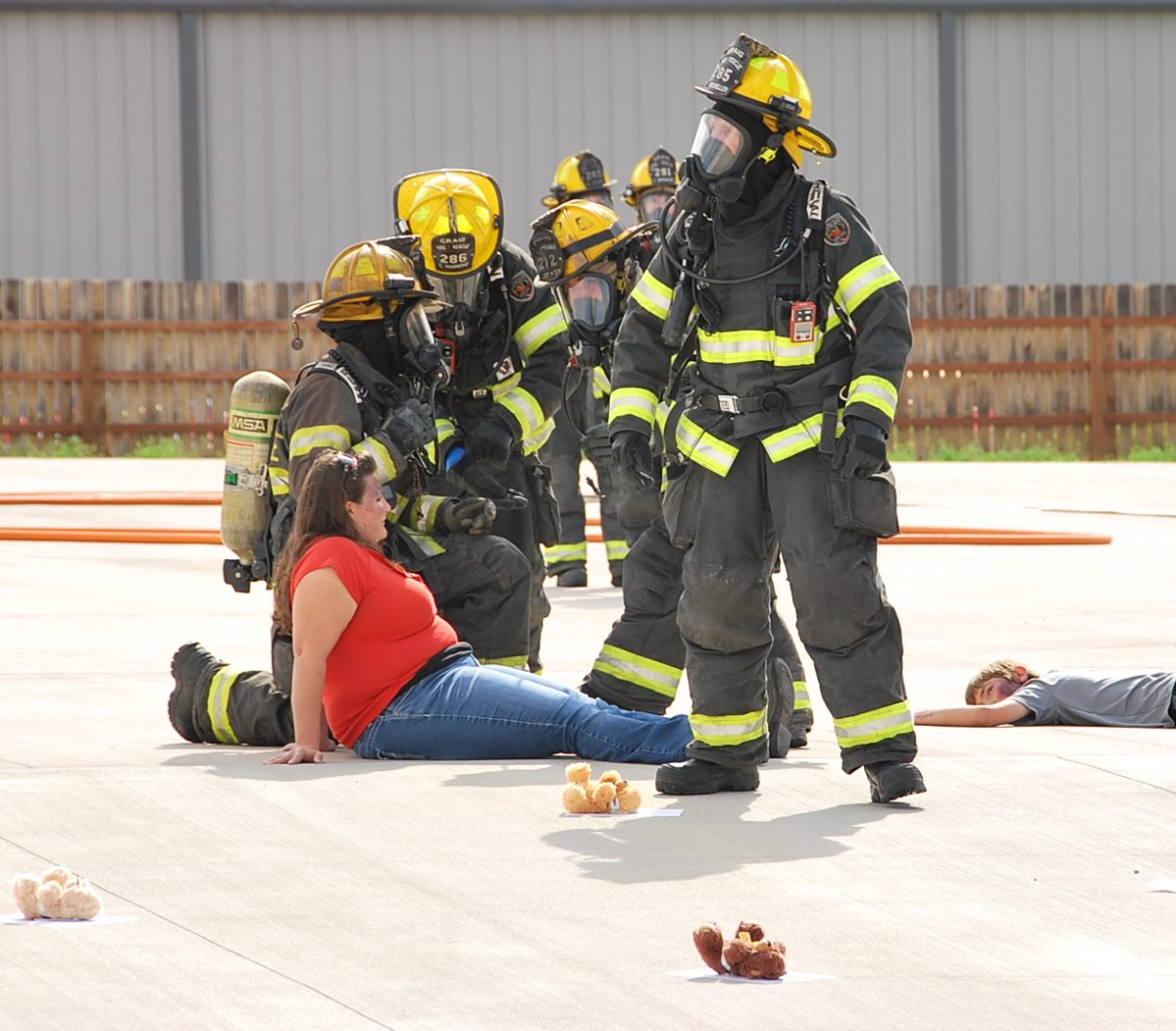 A Craig firefighter helps a volunteer victim during the training exercise.