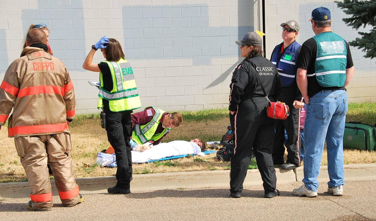 A makeshift triage is set up across the street to care for victims.