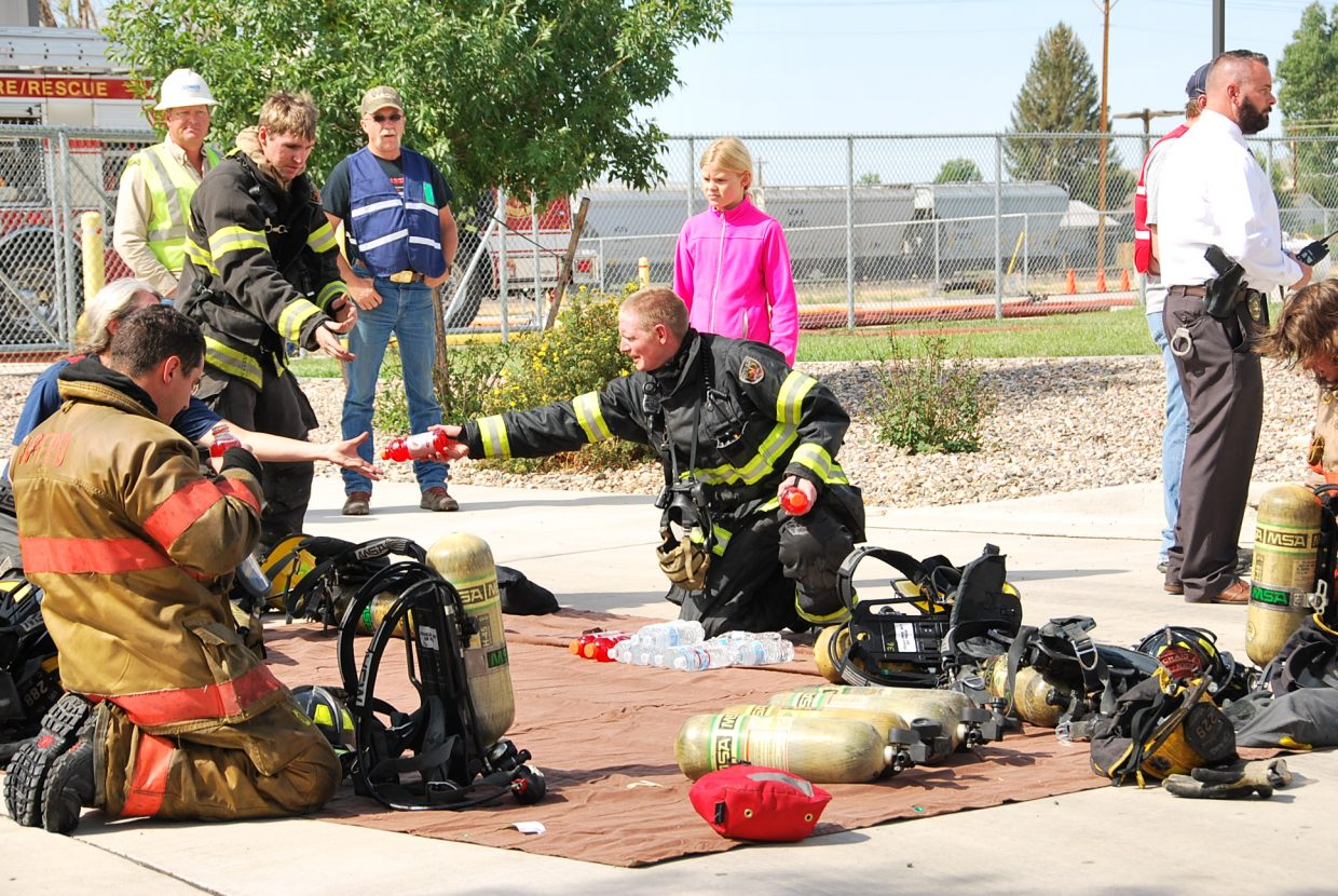 A firefighter hands out drinks to fellow firefighters during the training.