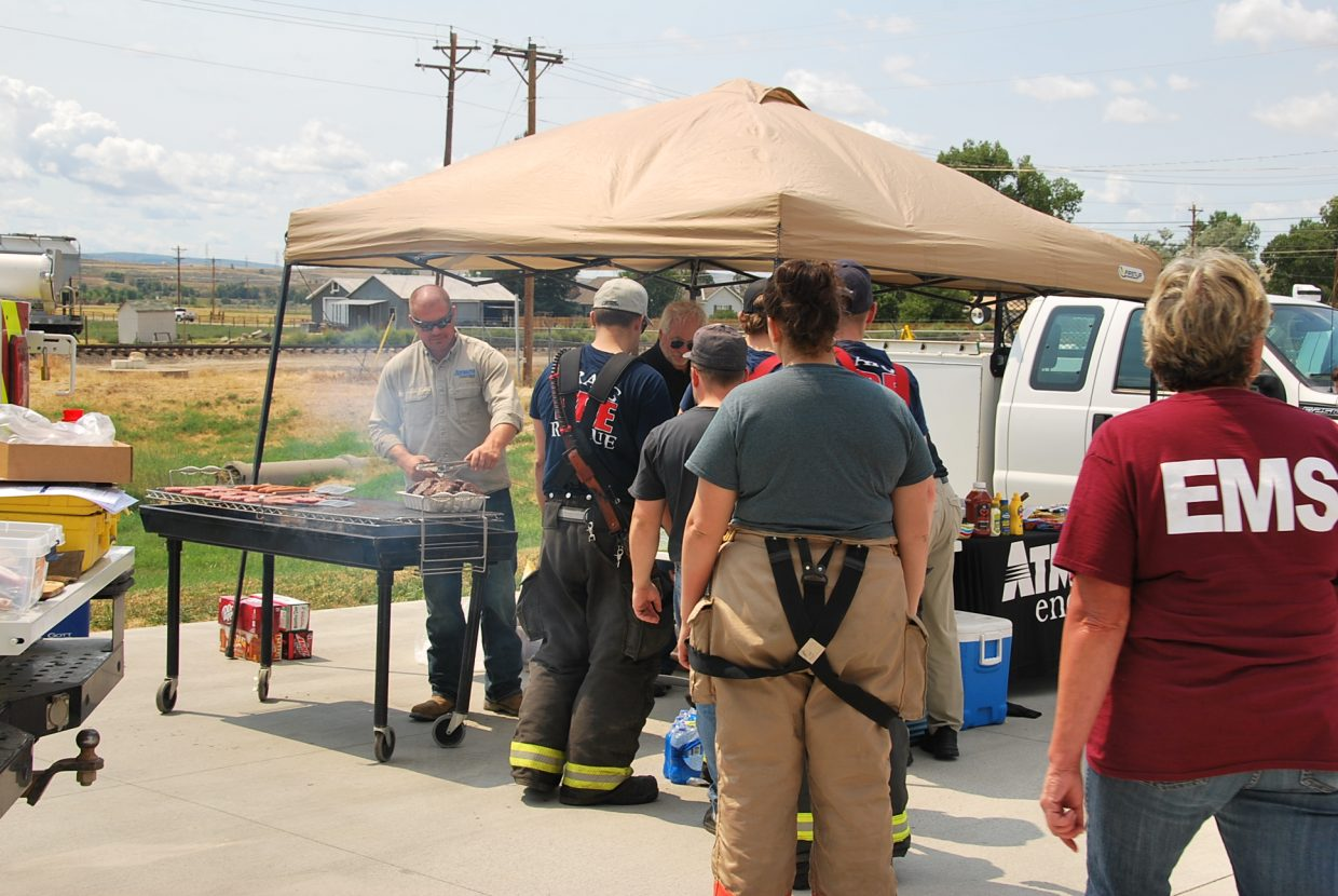 After the training, Atmos Energy grilled burgers for participants