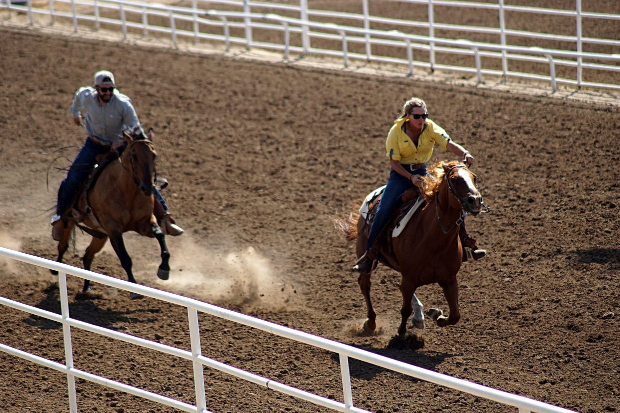 The cowgirl and her horse won the race and dinner by a couple lengths in In a grudge match between Raftopolis and Two Bar ranches.