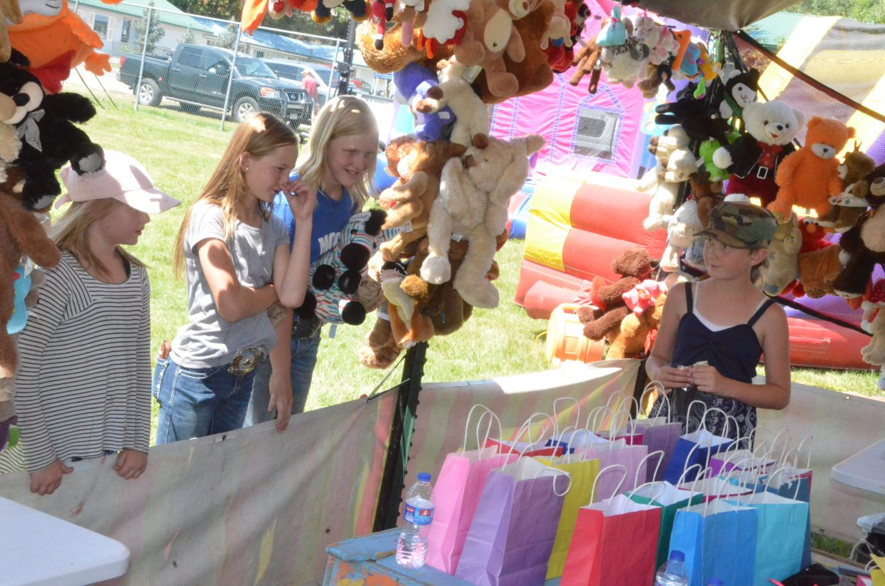 Carnival games and bounce houses from Adventure Zone provide entertainment for kids at the Moffat County Fair.
