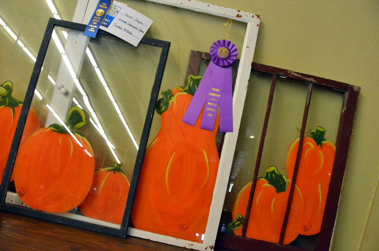 Teneil Jayne's painted glass is on display in the pavilion of Moffat County Fairgrounds.