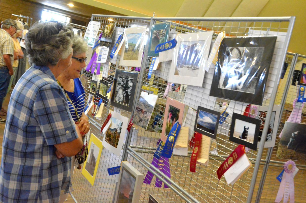 Spectators view award-winning photography in the pavilion of Moffat County Fairgrounds.
