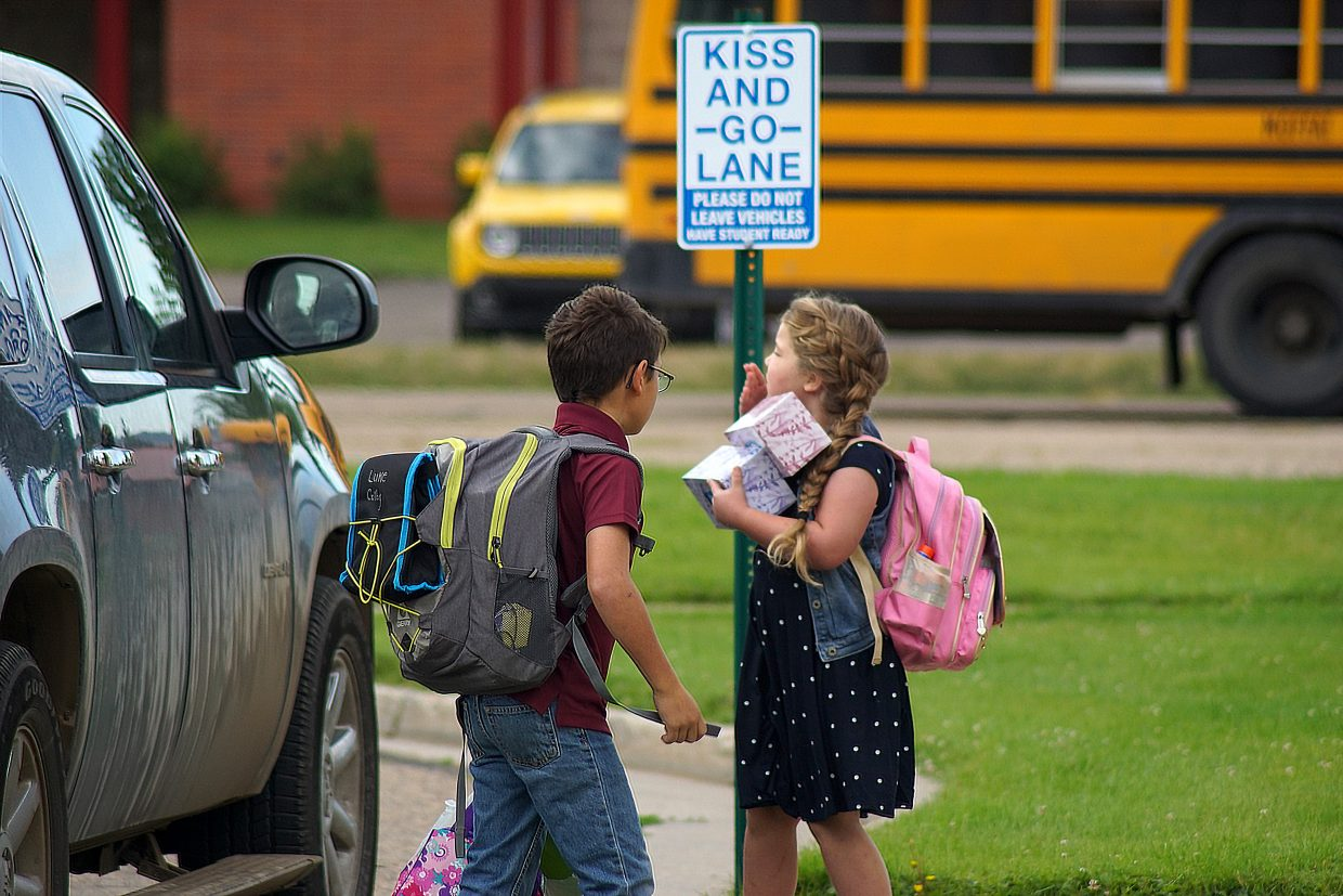 A Sunset Elementary School student blows her parent a kiss on the first day of the 2018-19 school year for Moffat County's traditional public schools.