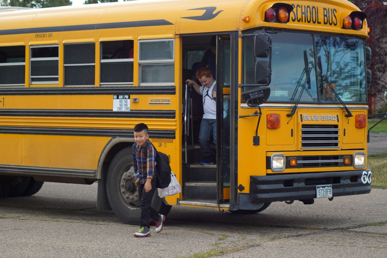 Students arrive by bus.