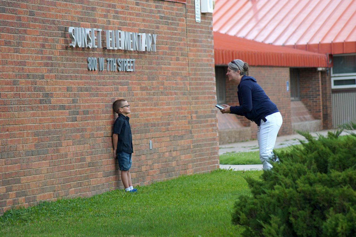 The brick wall at the front of the school is a favorite place for first day photos.