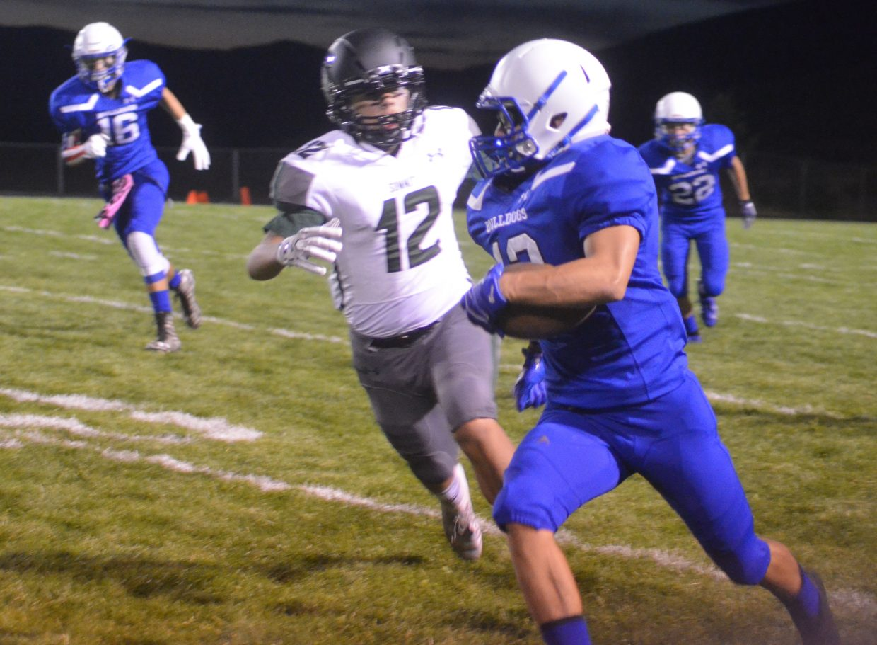 Moffat County High School's Victor Silva tucks away the ball after a catch and sprints for the end zone.
