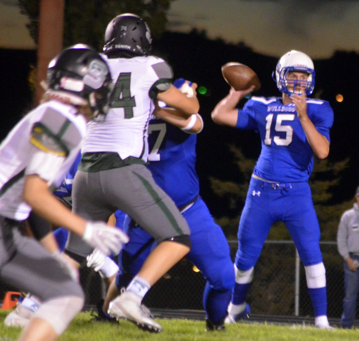 Moffat County High School's Colby Beaver rocks back for a pass.
