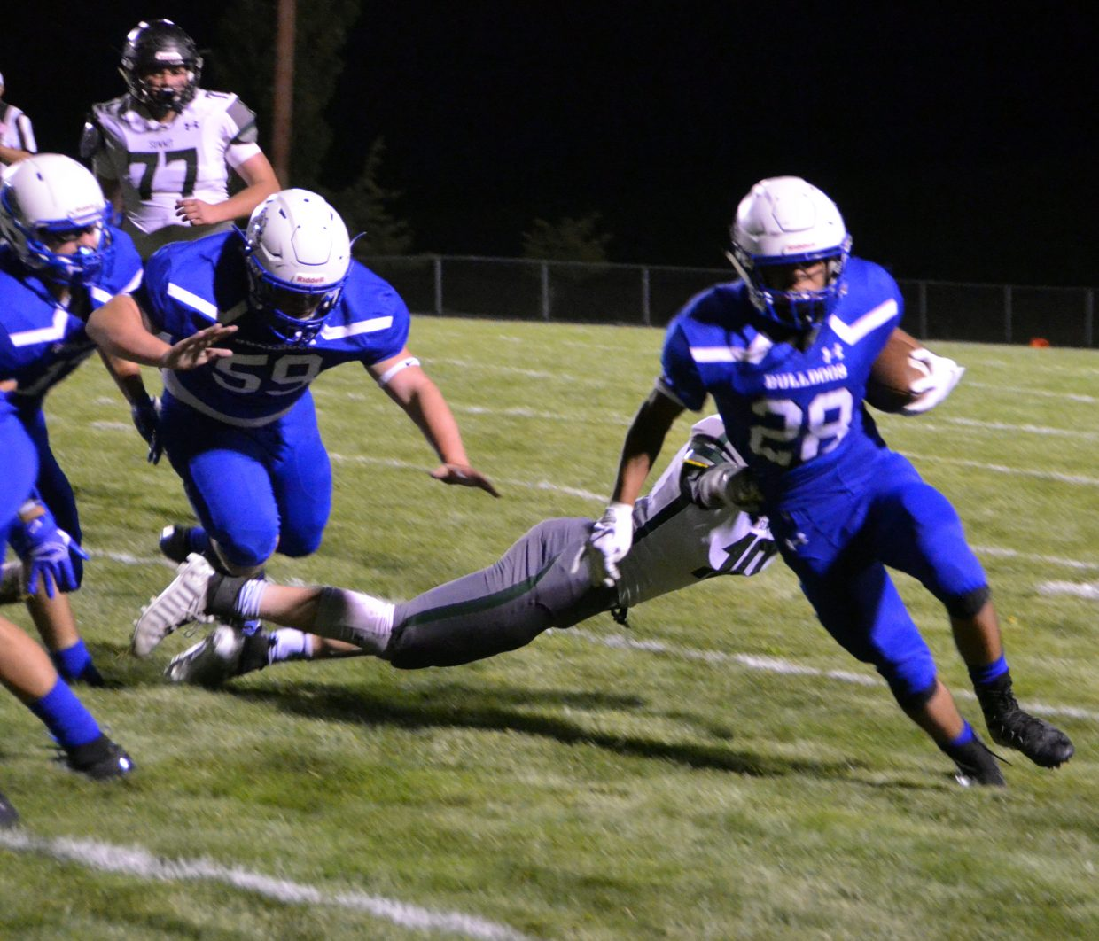 Moffat County High School's Kevin Hernandez shrugs off a Summit tackle.