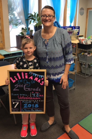 Lilliana Oliver stands with Second-grade teacher Katie Wheeler at Ridgeview Elementary School.