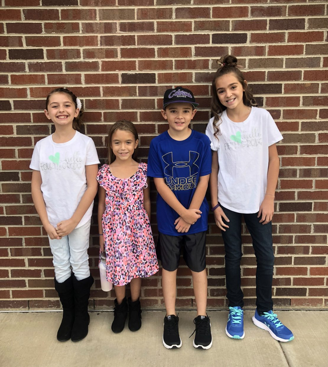 First day for Sandrock Elementary School students, from left: Forth grader Crystalynn Poole, second grader Emmalynn Poole, third grader Liam Mannon and fifth grader Jordyn Mannon.