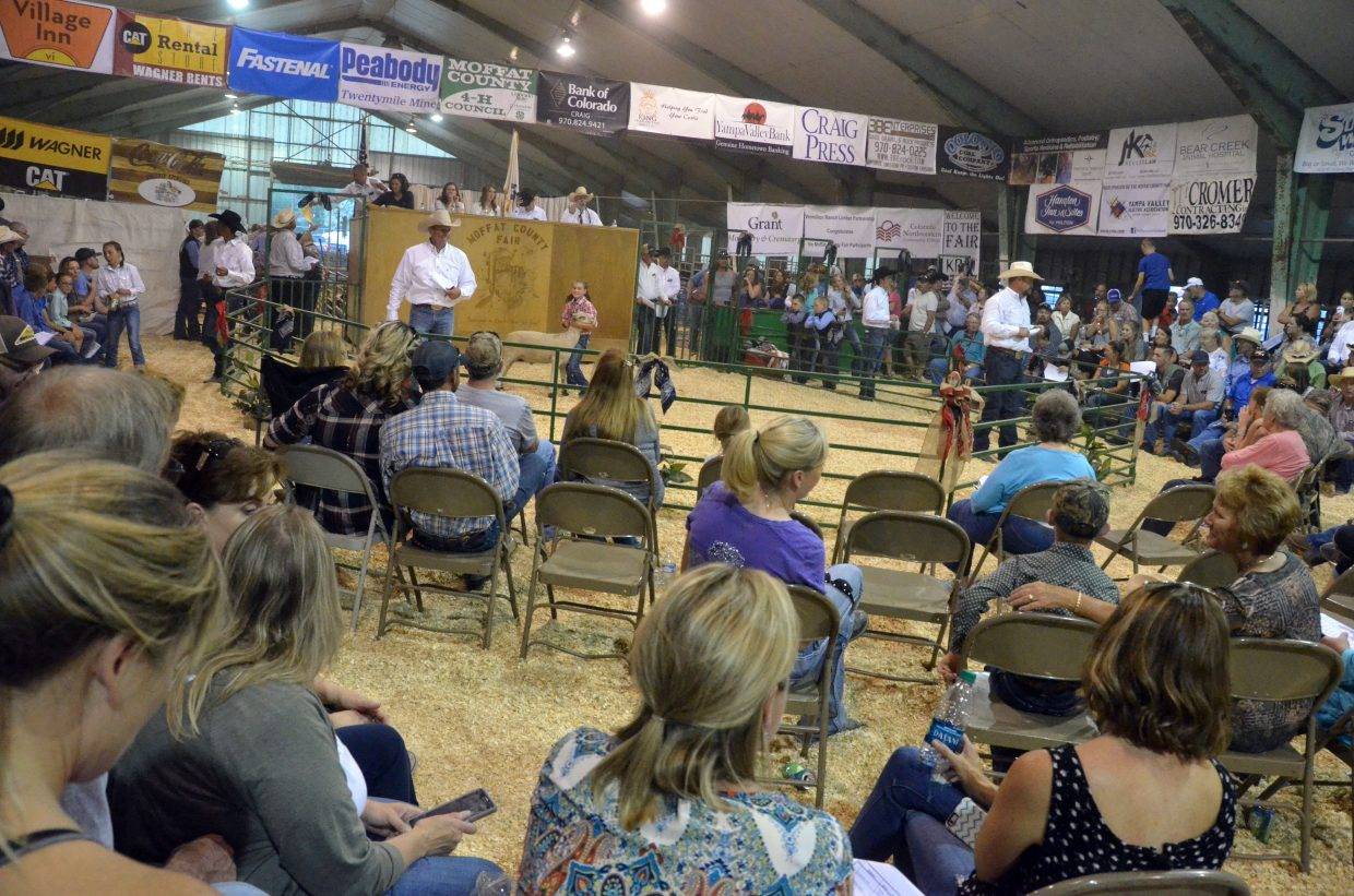 The livestock barn of the Moffat County Fairgrounds is packed with patrons ready to purchase market animals at the 100th Moffat County Fair.
