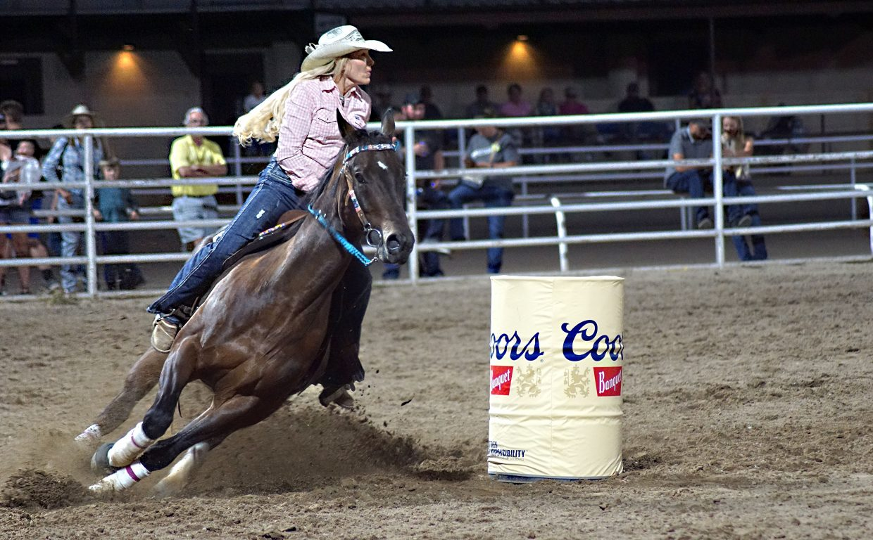 Eight women of the Women's Professional Rodeo Association show their skill in the barrel racing competition.