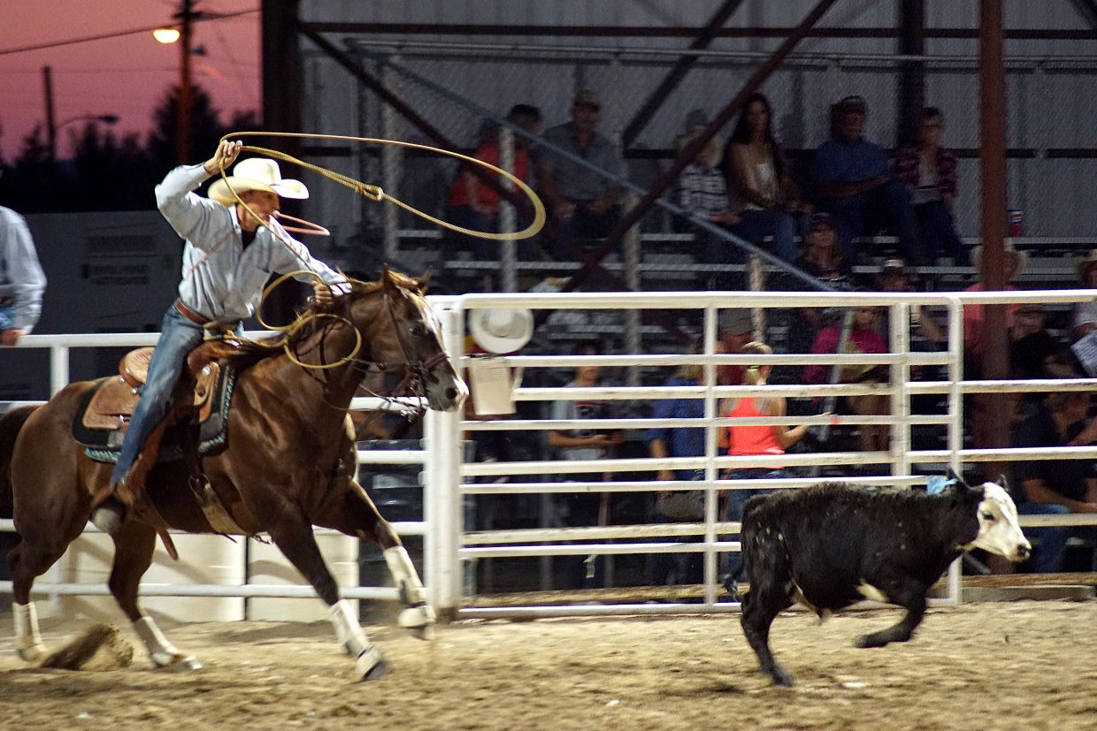 A cowboy races after a calf during the tie-down competition in 2018.