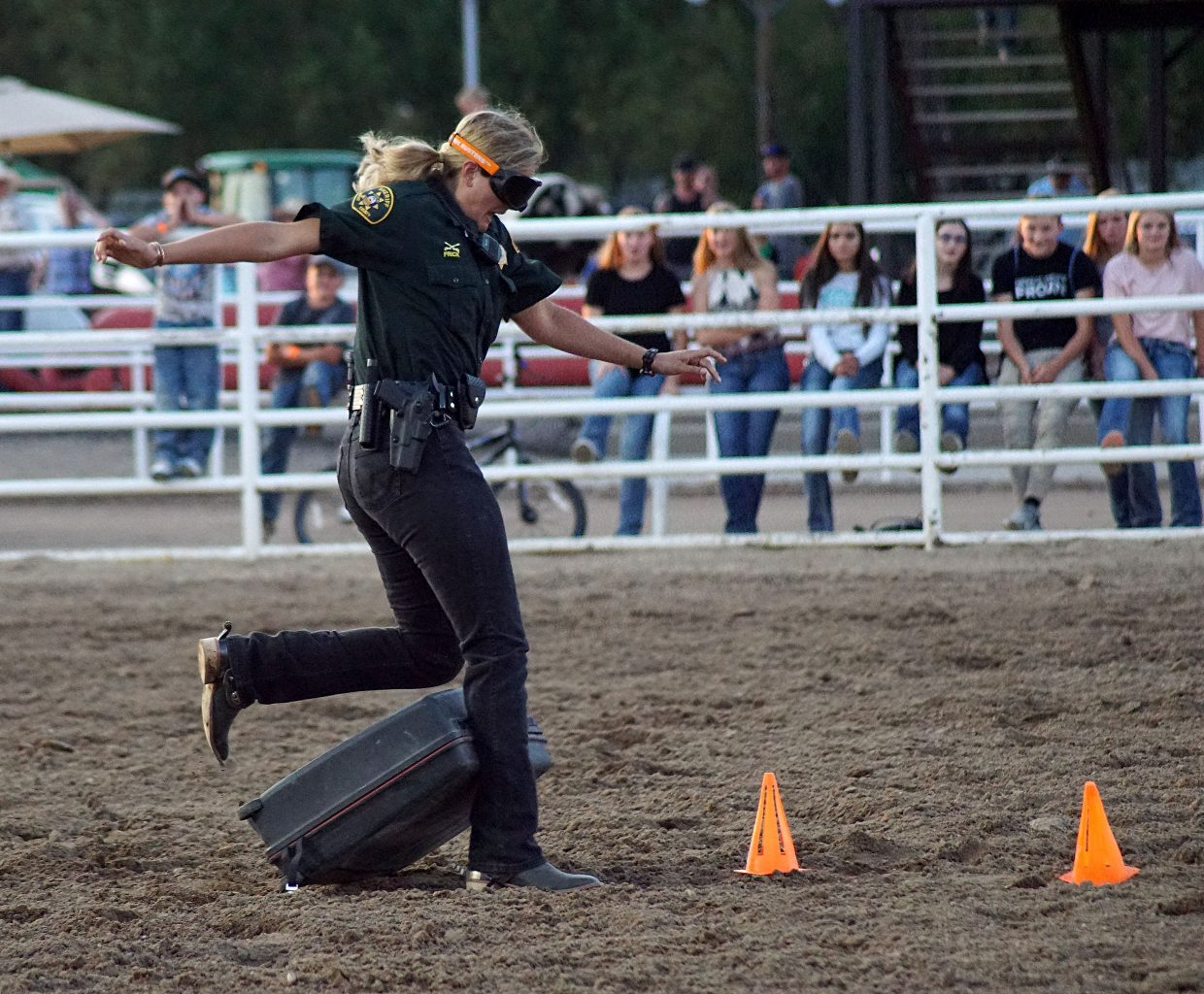A Moffat County Sheriff's Office deputy from the mounted division entertains the rodeo crowd between events by trying to run an obstacle course while wearing