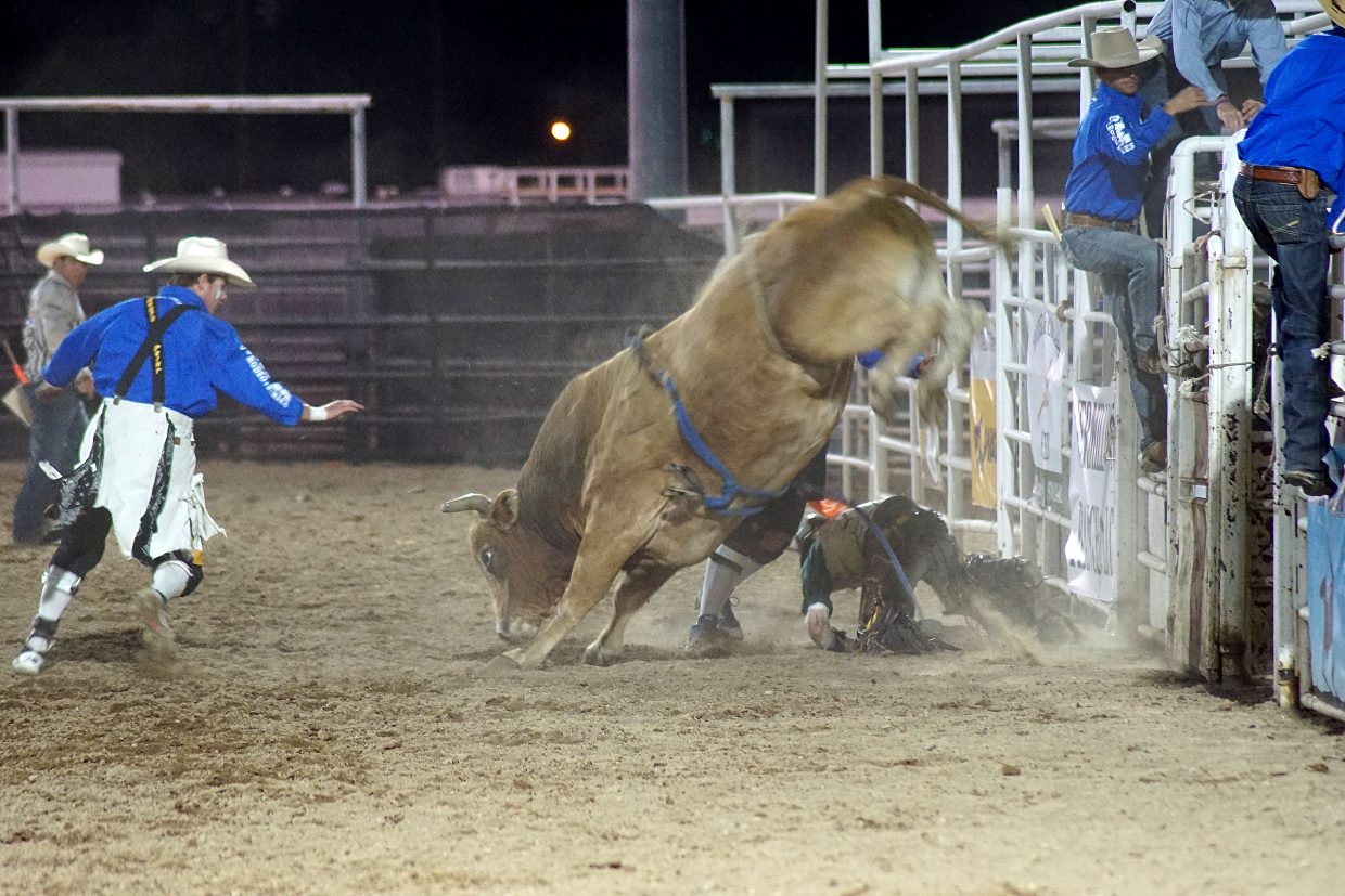 A rider falls to the dirt.