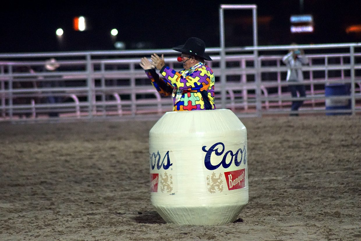 Entertainer Donnie Landis stands in a barrel during bull riding.