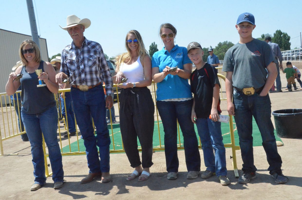 The top four turtles and their handlers celebrate victories following the turtle races Saturday at the Moffat County Fair.