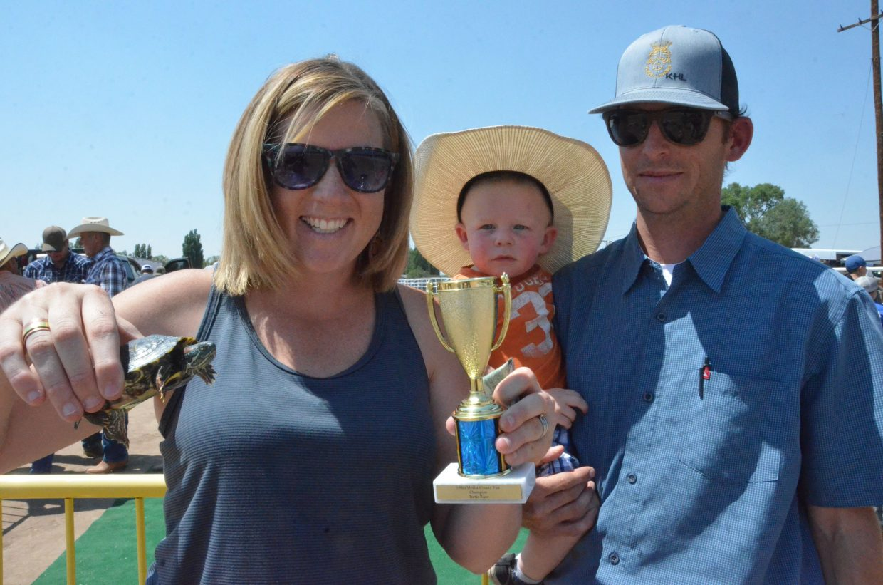 The Lyons family, Kacey, Chasen and Kyle, display their winning animal and prize from Saturday's turtle races at the Moffat County Fair. Kacey won $1,100 in the event and donated $500 back to the fair board.