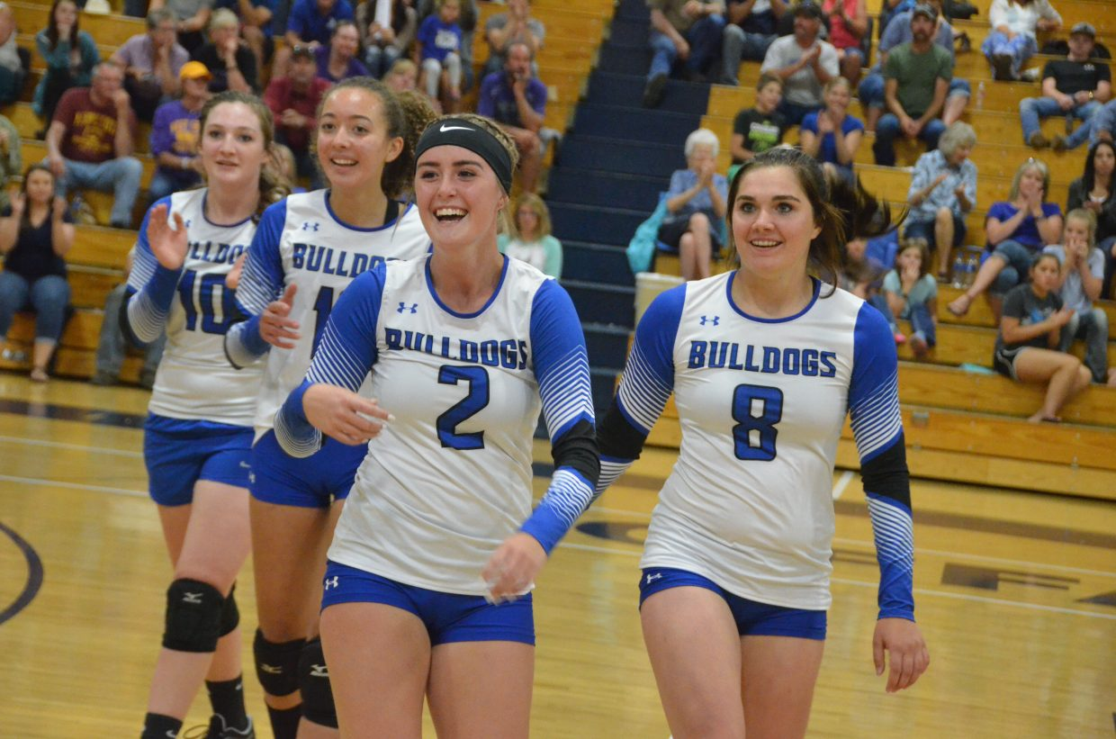From left, Moffat County High School varsity volleyball players Tiffany Hildebrandt, Olivia Profumo, Bailey Lawton and Jenna Timmer come off the court in a state of euphoria Tuesday night. The Lady Bulldogs' first home game ended in a 3-2 win against West Grand.