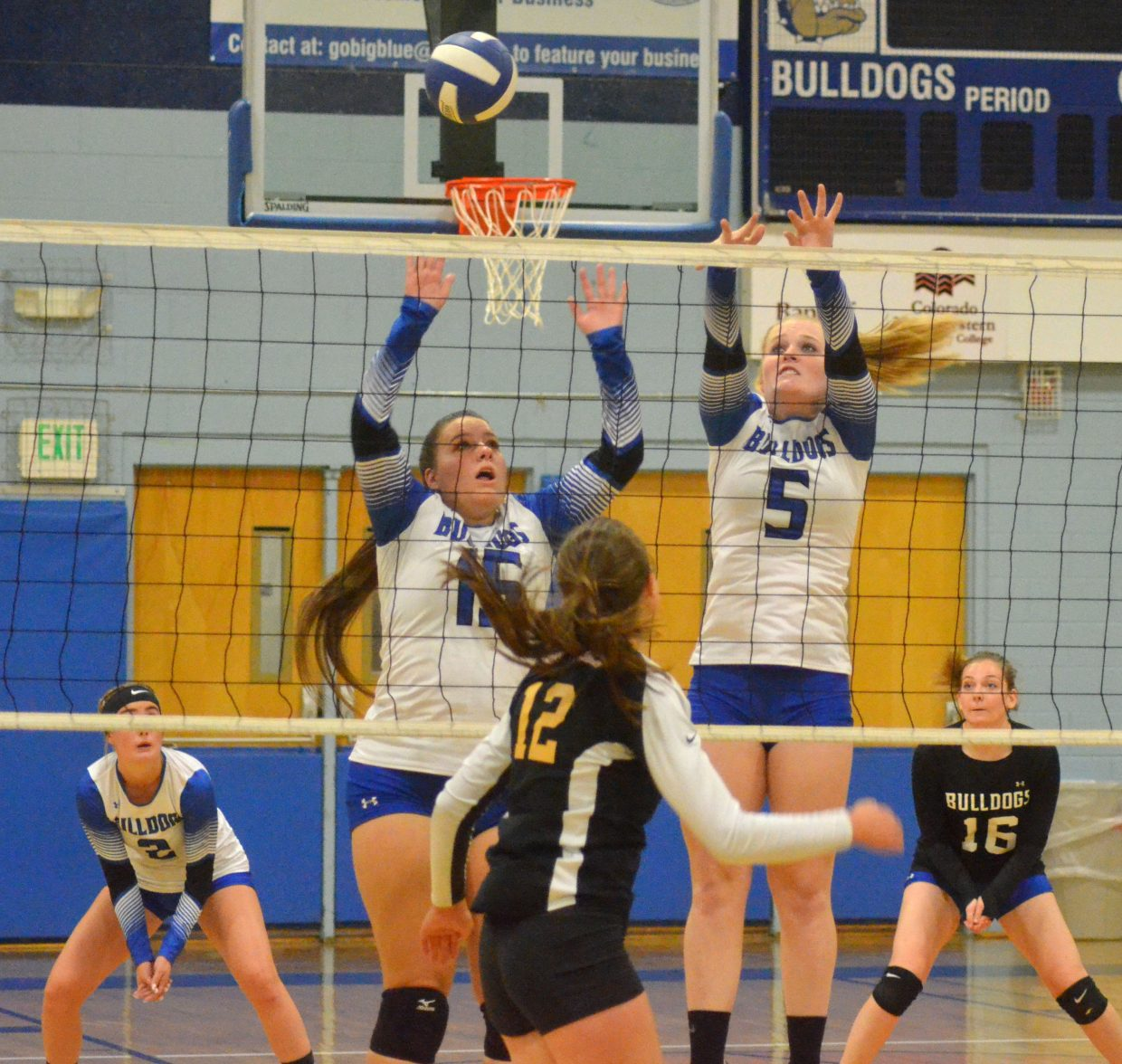 Moffat County High School's Ebawnee Smercina, left, and Jaidyn Steele work for the block against West Grand.