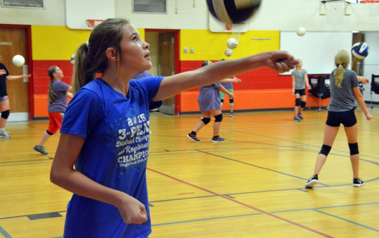 Cayden King juggles a volleyball with one-armed bumps during the Parks and Recreation Volleyball Camp at Sandrock Elementary School.