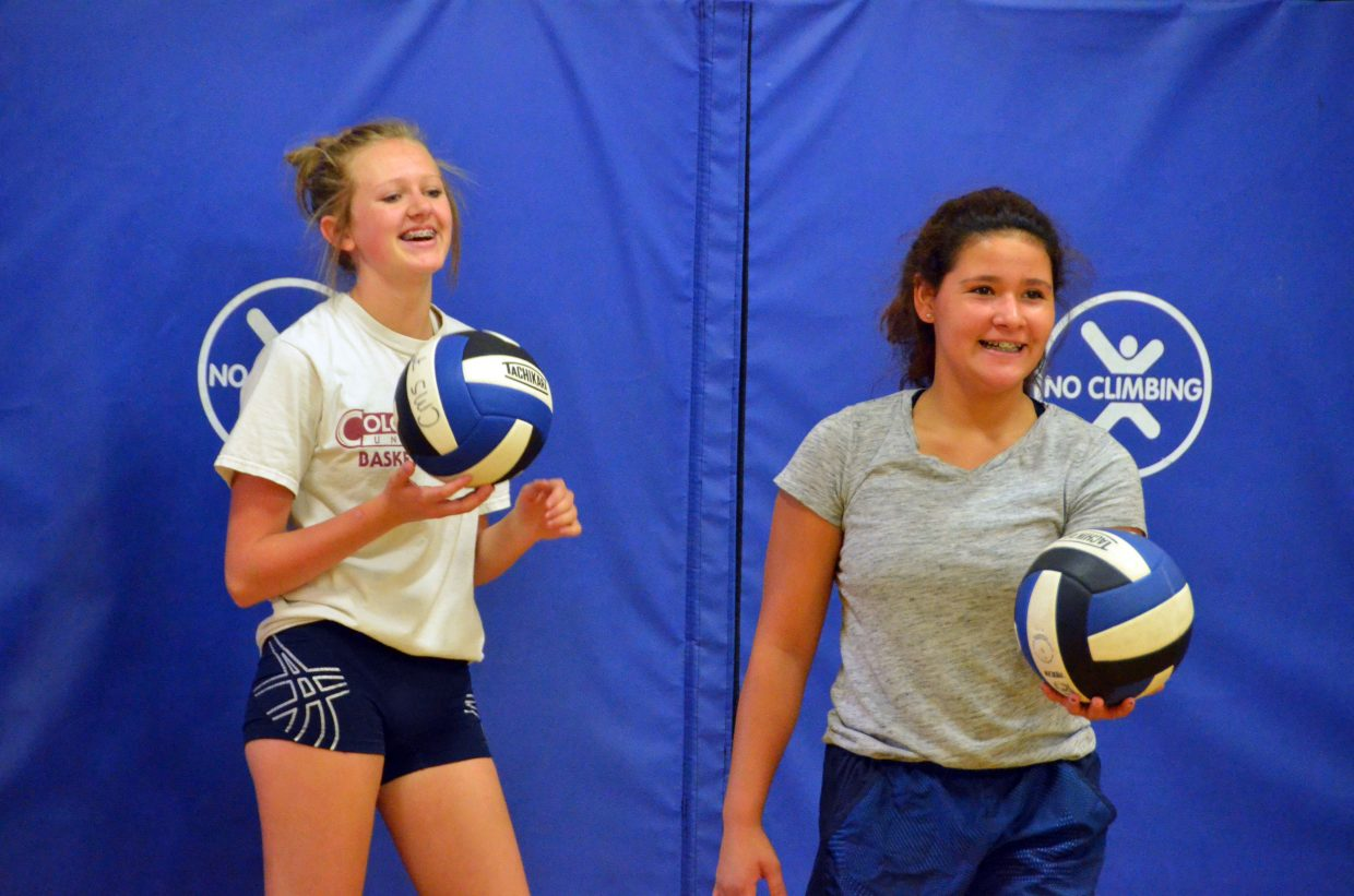 Marlee Fedinec, left, and Shay Wait get warmed up at the Parks and Recreation Volleyball Camp at Sandrock Elementary School.