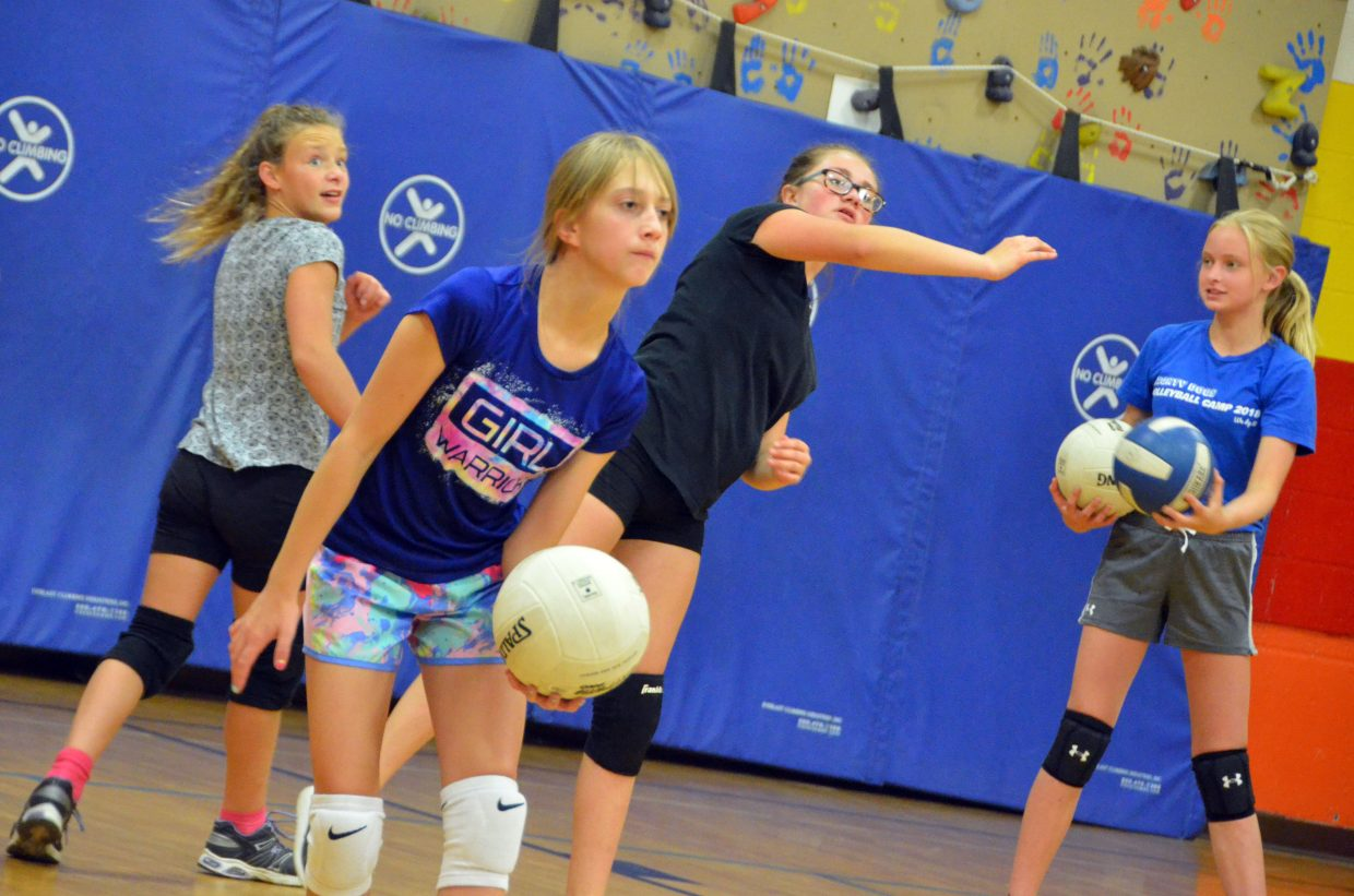 Players work on their game skills at the Parks and Recreation Volleyball Camp at Sandrock Elementary School.