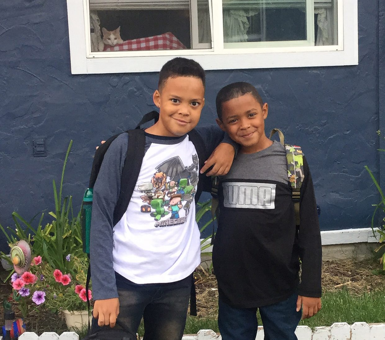 Third grader Treavon Wilson and second grader Tobias Wilson on their first day at Sandrock Elementary School were photo-bombed by their kitty Mabel.