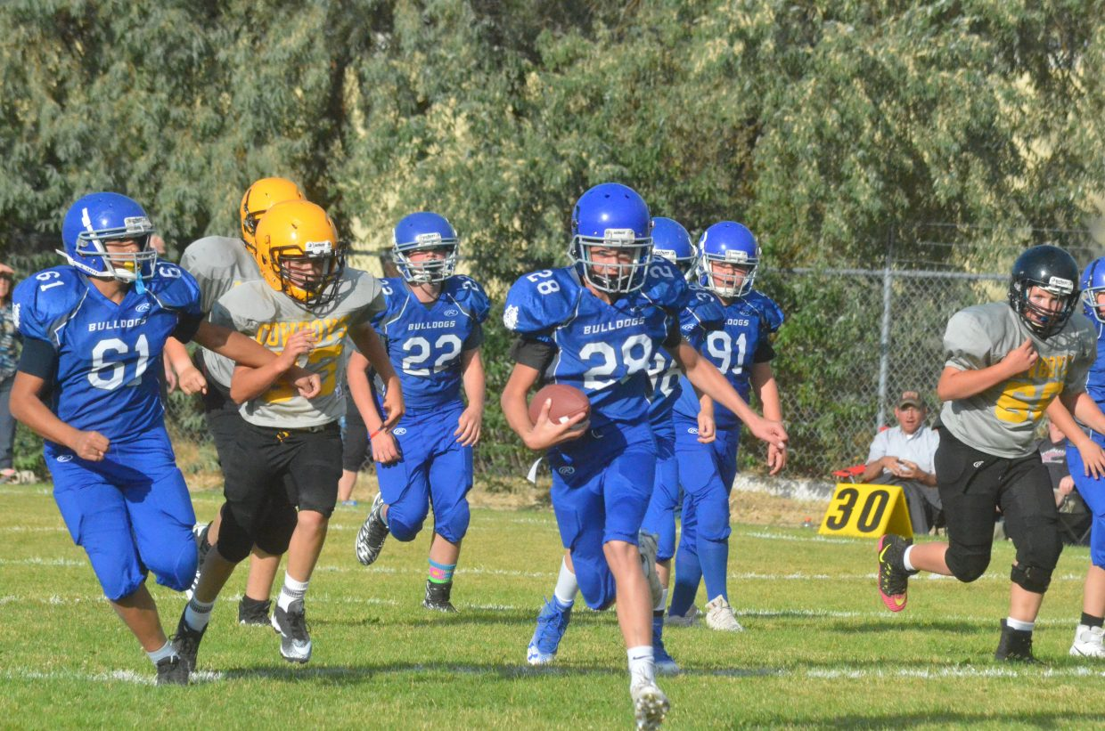 Craig Middle School's Evan Beaver finds a gap in the defense during CMS's Thursday game against Meeker.