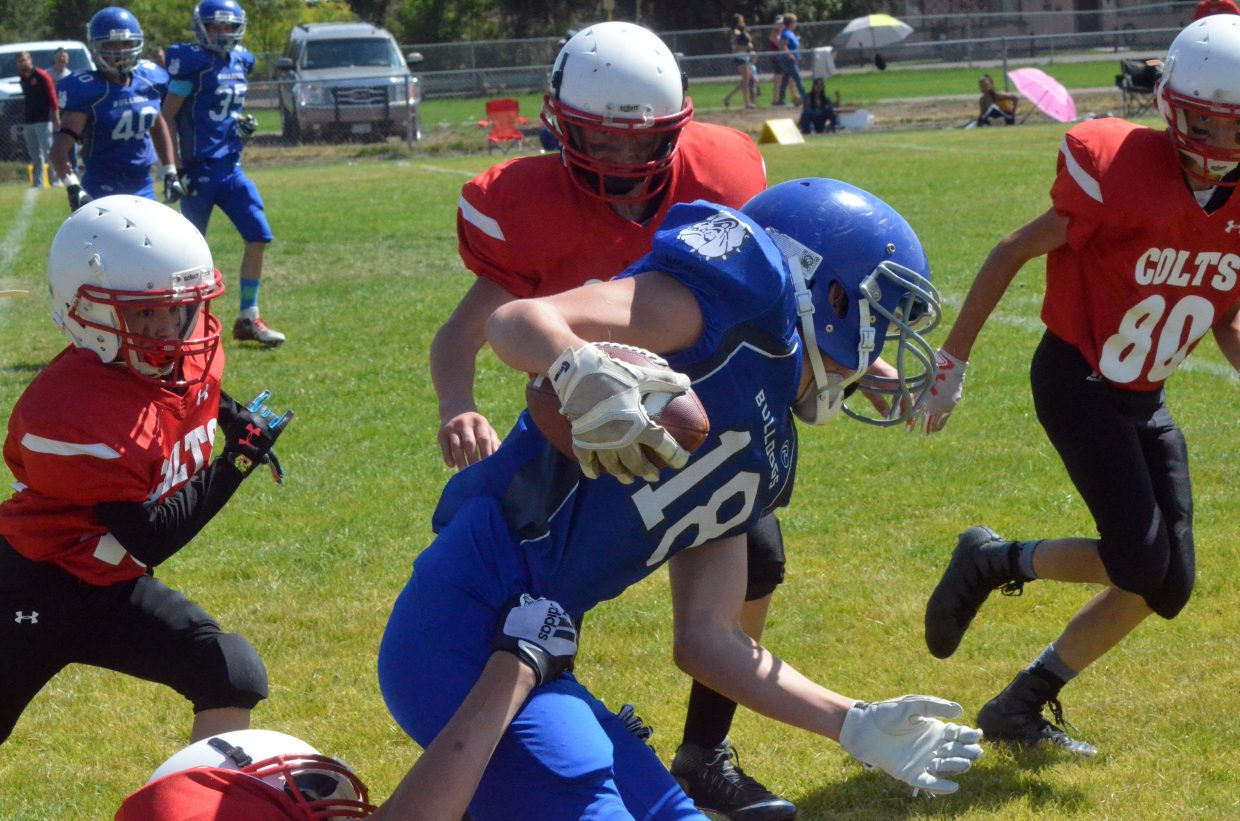 Craig Middle School's Evan Atkin keeps gaining yardage after the catch against Rawlins.