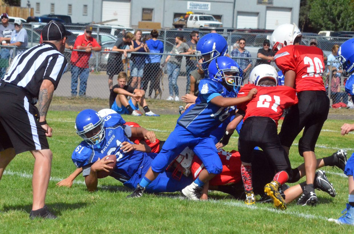 Craig Middle School's Alexis Barraza fights his way into the end zone against Rawlins.