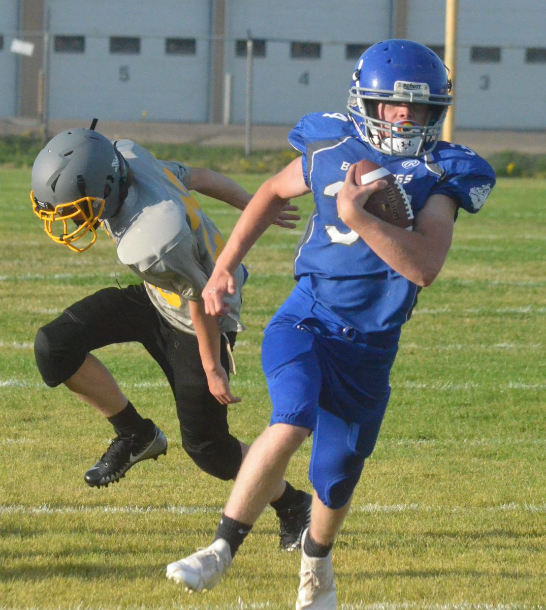 Craig Middle School's Chayton McDonald evades a tackle from Meeker.