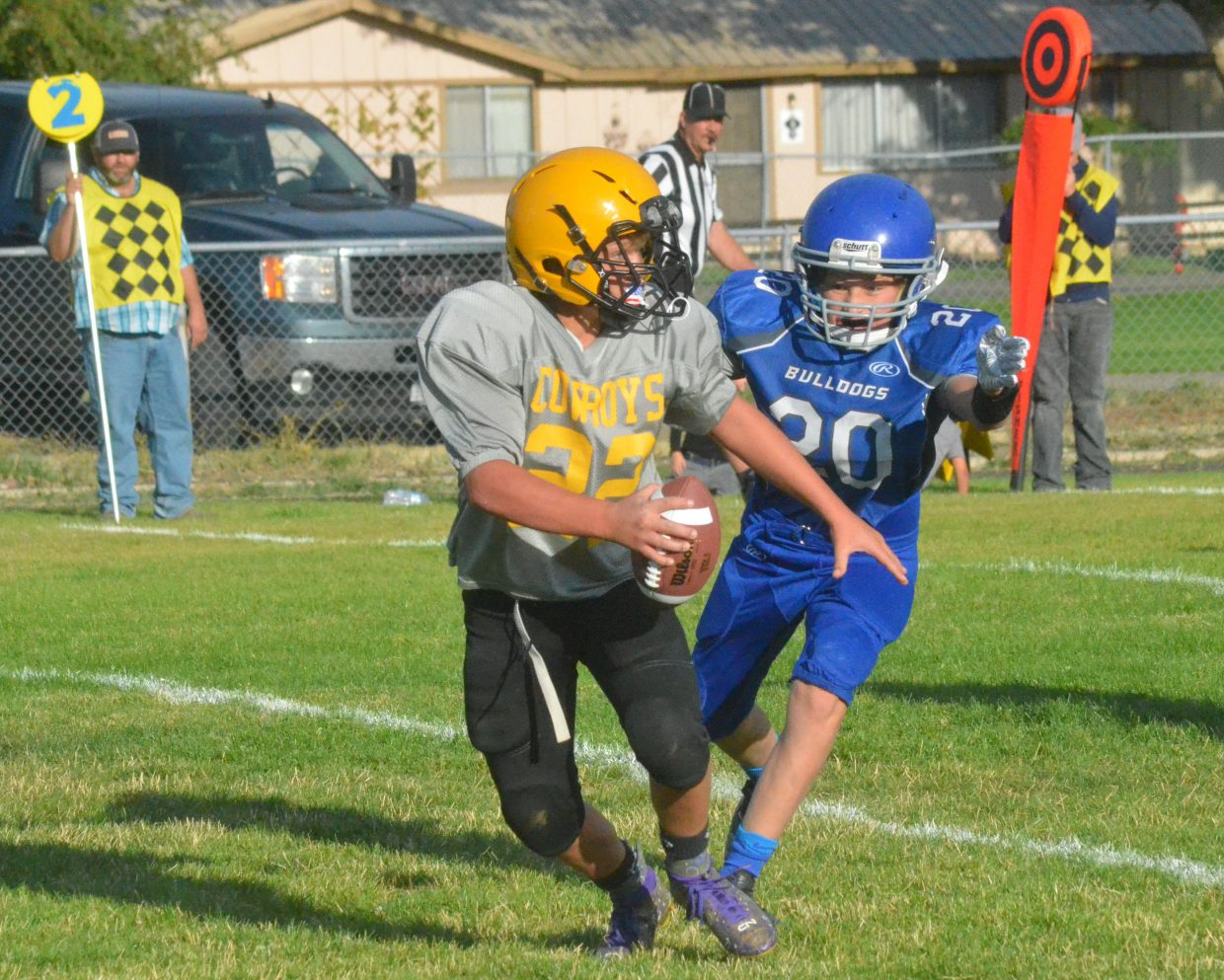 Craig Middle School's Tallyn Wgner charges in for a potential sack against Meeker.