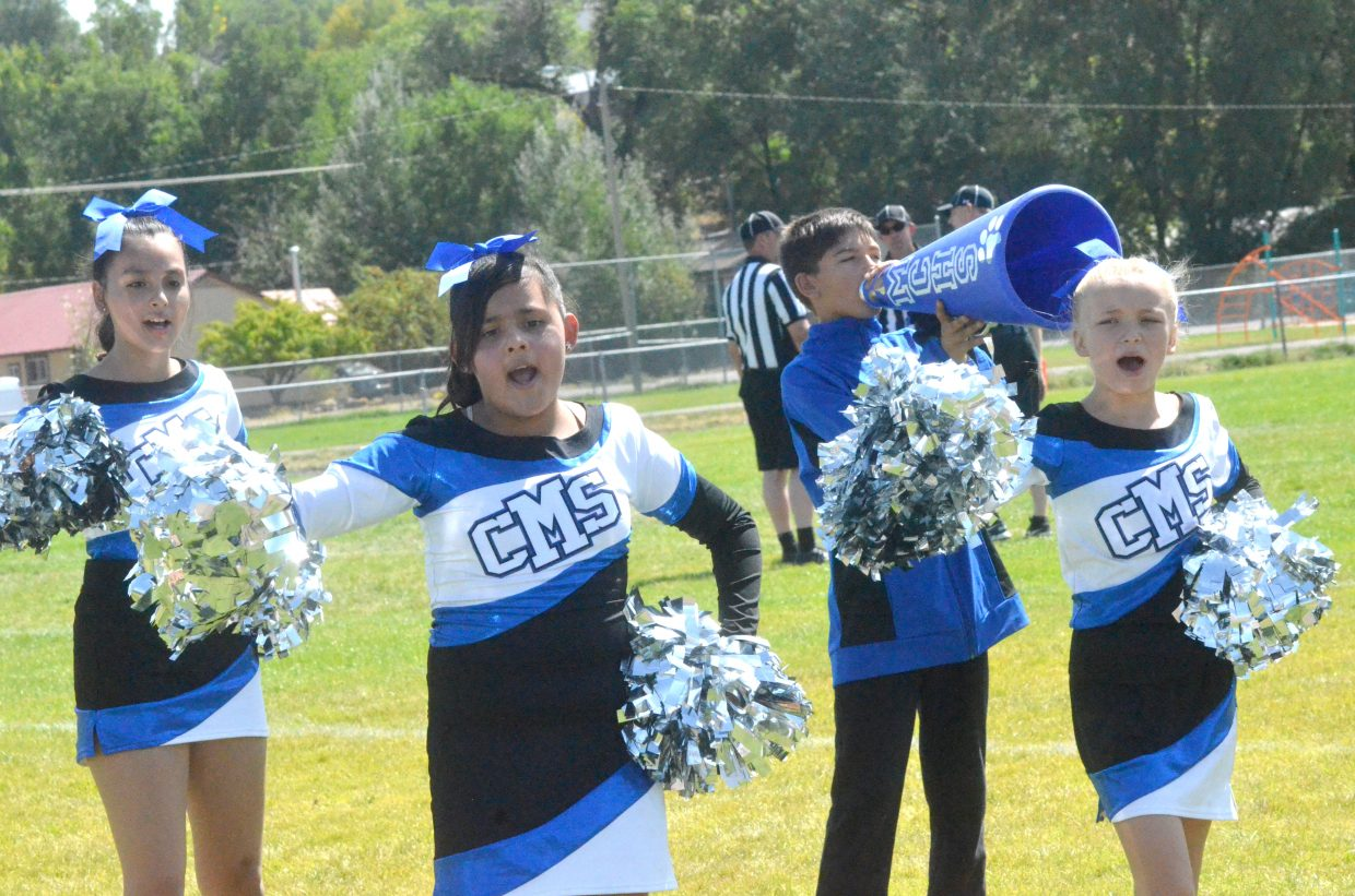 Craig Middle School cheerleaders perform at halftime for the crowd during Bulldog football's game with Rawlins.
