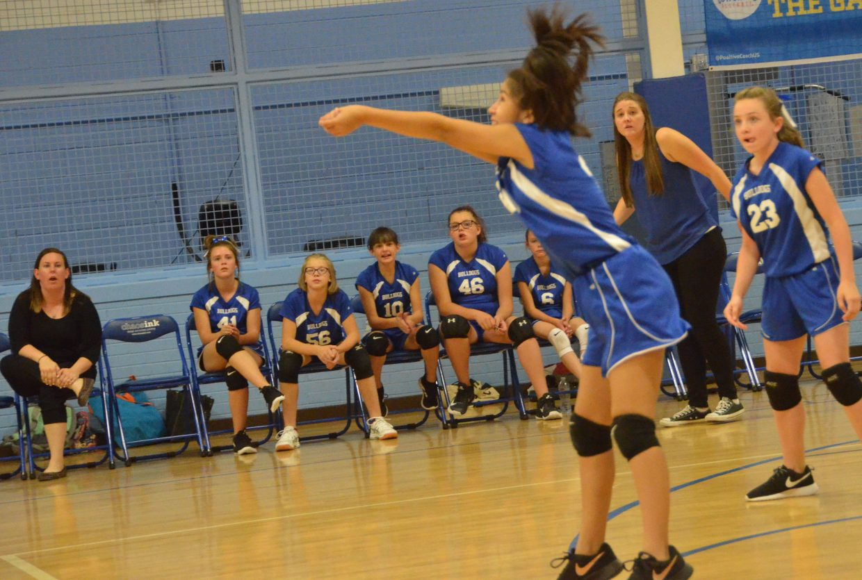 Craig Middle School seventh-graders and coaches look on as Joselyn Moriel sends the ball over the net.