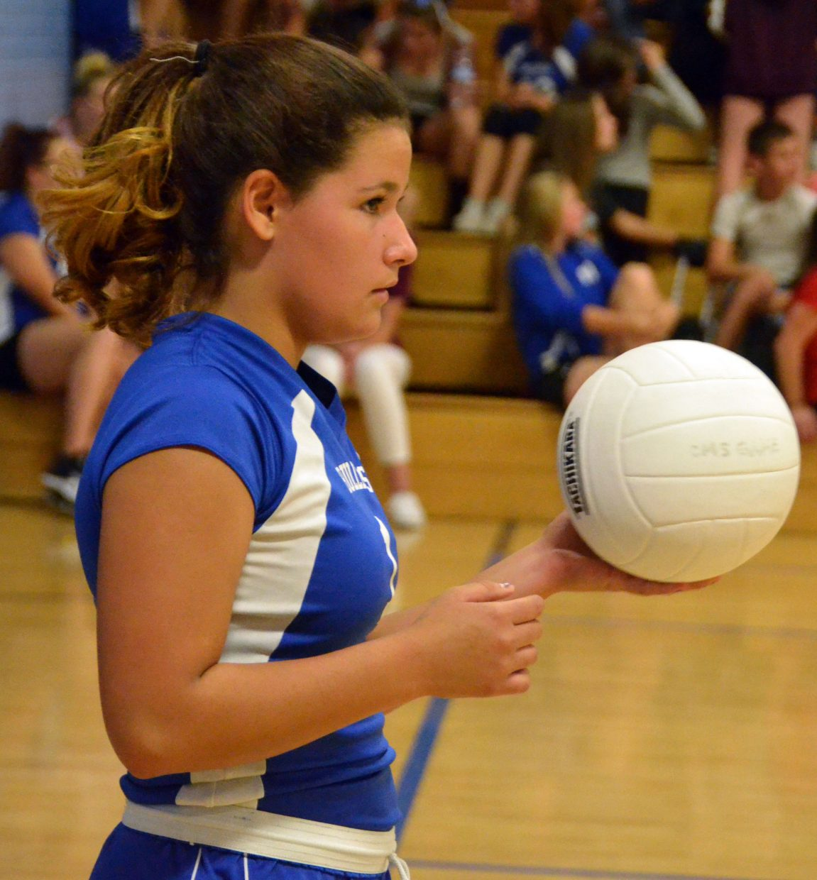 Craig Middle School's Shay Wait readies for a serve during CMS's home game against Baggs, Wyoming.