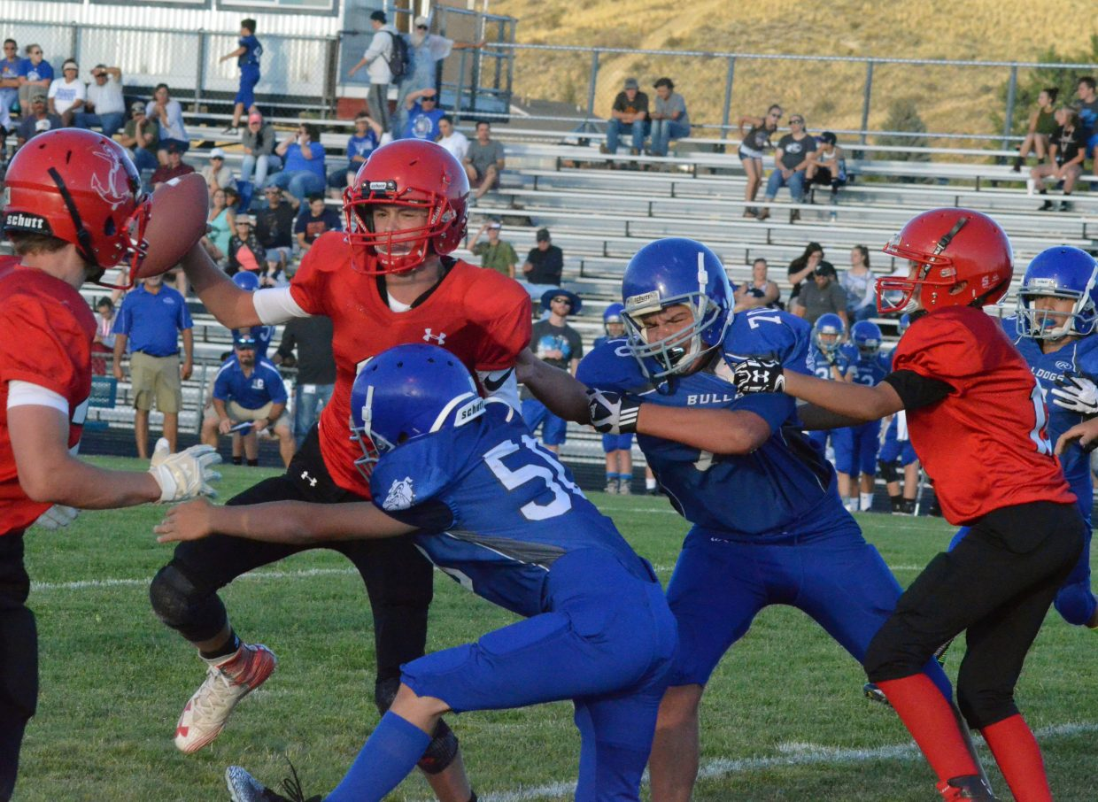 A Steamboat Springs pass attempt is hurried thanks to the Craig Middle School defense.