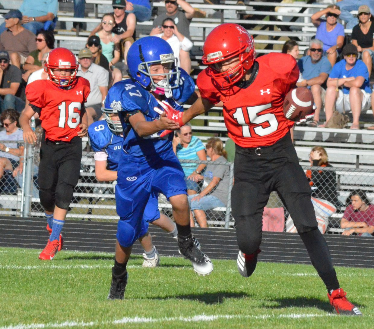 Craig Middle's School's Kenny Fredrickson looks to gain a sack against Steamboat Springs.