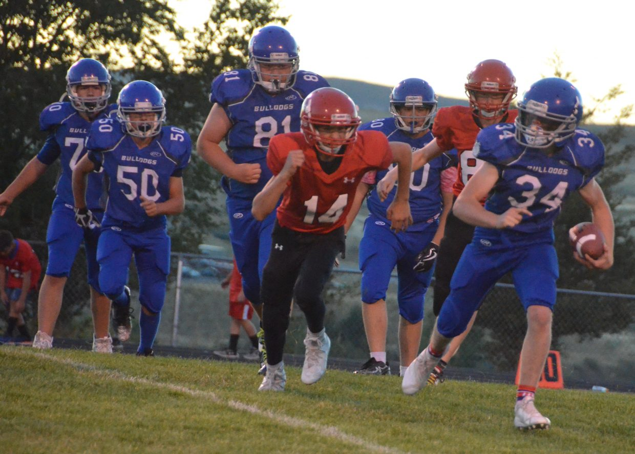 Craig Middle's School's Chayton McDonald gets around the Steamboat Springs defense.