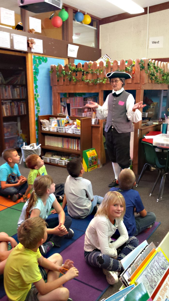 Students at Sunset Elementary School listen to a Constitution Week presentation by Debbie McClain, chair of the Constitution Committee of the local chapter of the Daughters of the American Revolution.